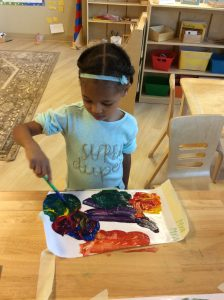 Student Painting at Villa Montessori Preschool Polaris