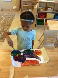 Student Painting at Villa Montessori Preschool Polaris